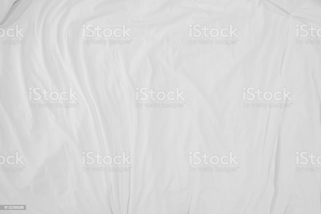 Top view of bedding sheets crease,white fabric wrinkled texture