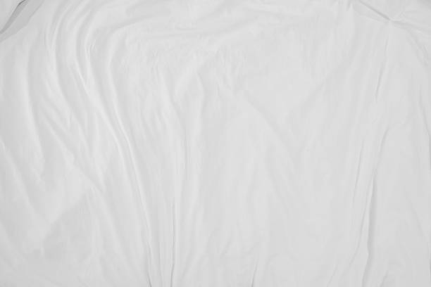 Top view of bedding sheets crease,white fabric wrinkled texture stock photo