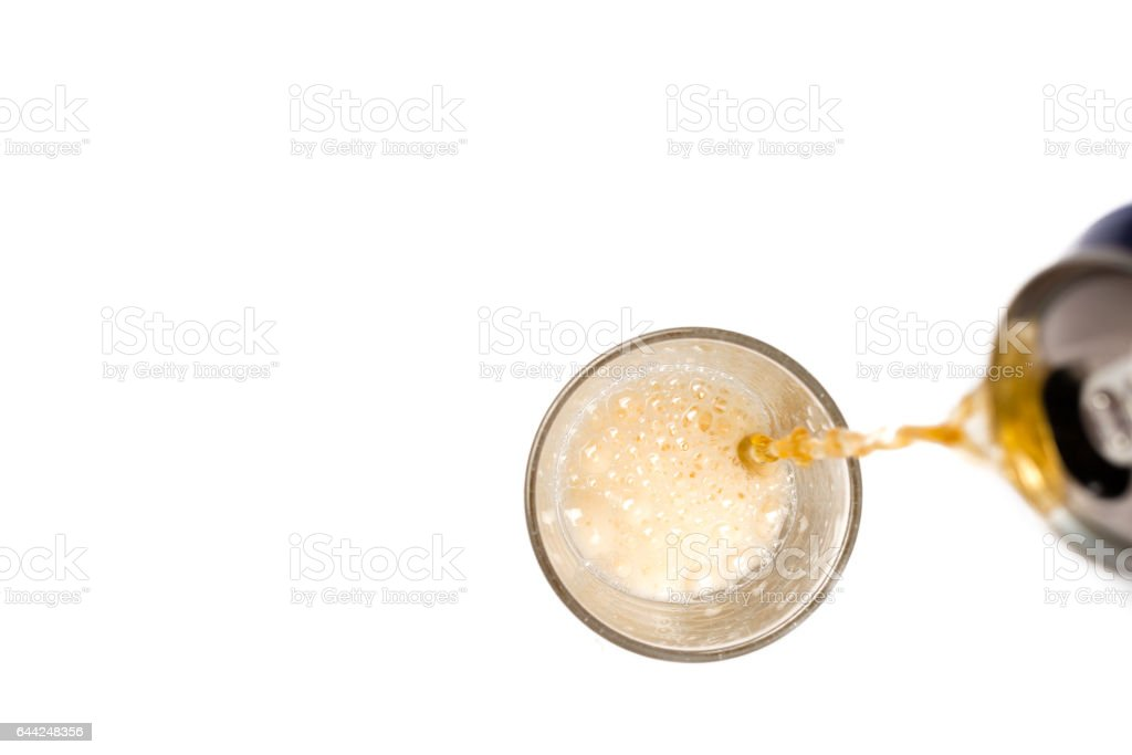 Top view of beer pouring into a glass stock photo