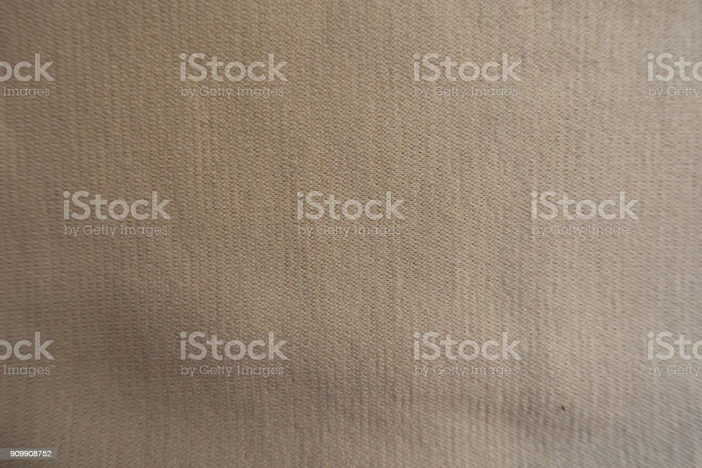 Top view of beige jersey fabric surface stock photo