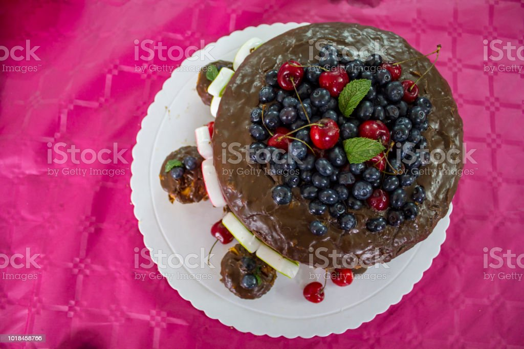 Top View Of Birthday Cake Chocolate Cake With Red Fruits Stock Photo