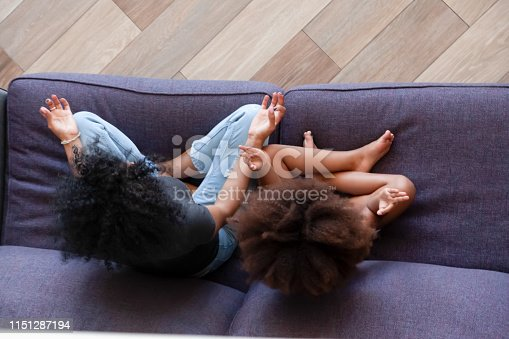 916126642 istock photo Top view of black mom and small daughter meditating together 1151287194