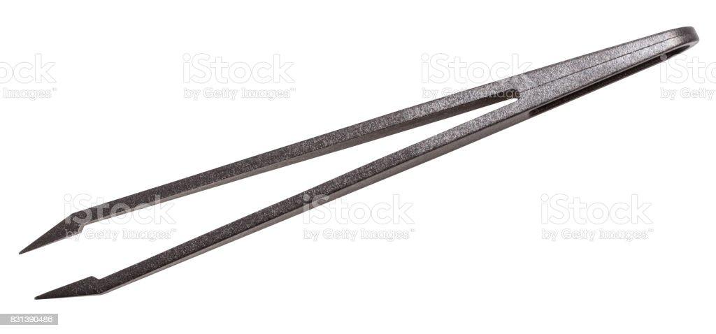 top view of black plastic anti-static tweezers stock photo
