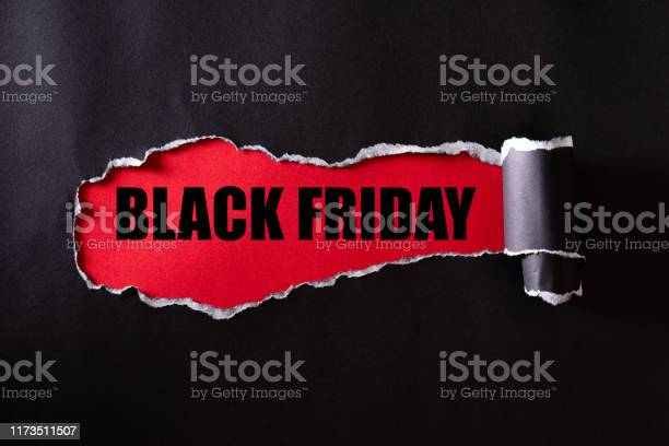 Top View Of Black Torn Paper And The Text Black Friday On A Red Background Black Friday Composition Stock Photo - Download Image Now