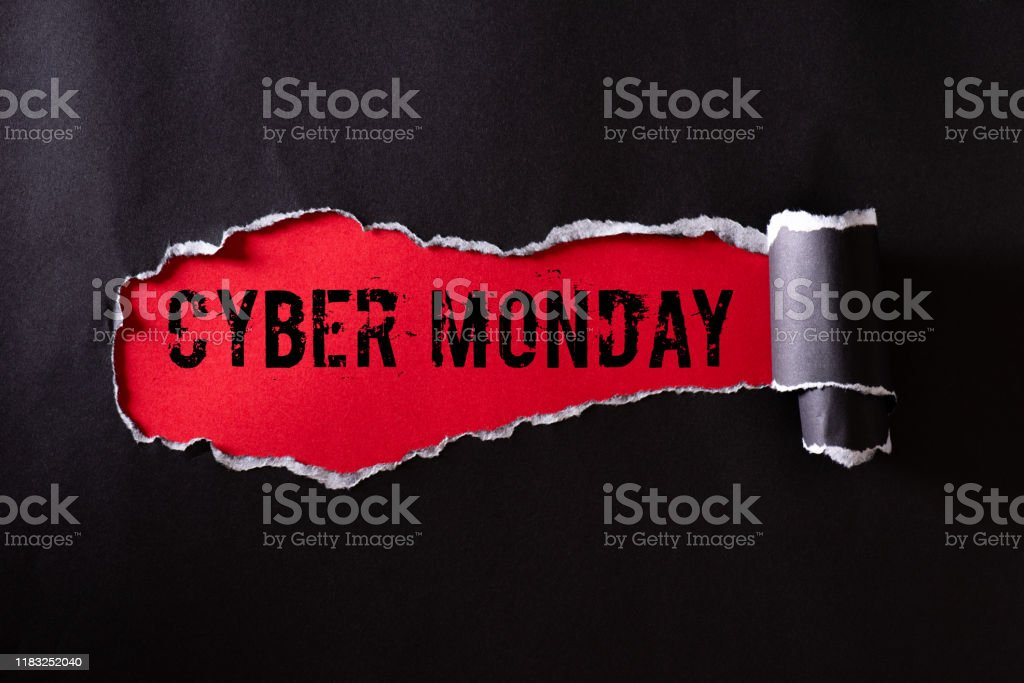 Top view of Black torn paper and the text Cyber Monday on a red background. Cyber Monday composition. - Стоковые фото Бизнес роялти-фри