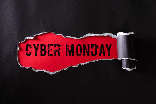 istock Top view of Black torn paper and the text Cyber Monday on a red background. Cyber Monday composition. 1183252040