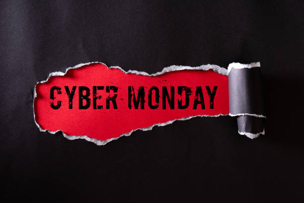 top view of black torn paper and the text cyber monday on a red background. cyber monday composition. - cyber monday zdjęcia i obrazy z banku zdjęć