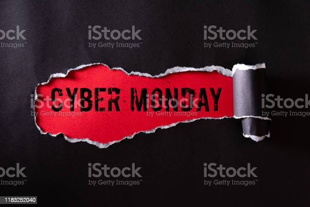 Top View Of Black Torn Paper And The Text Cyber Monday On A Red Background Cyber Monday Composition — стоковые фотографии и другие картинки Бизнес
