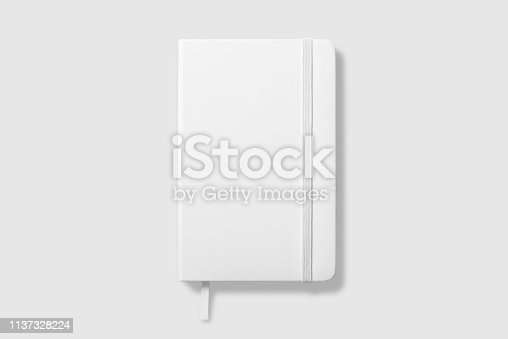 istock Top view of Blank photorealistic notebook mockup on light grey background. 1137328224