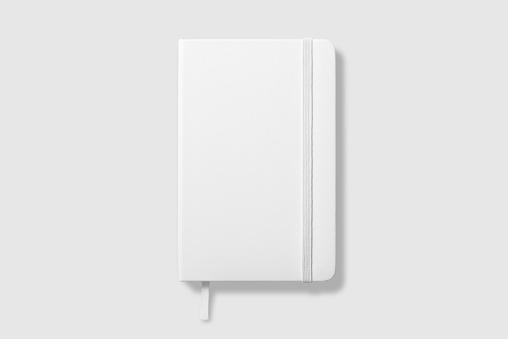 明るい灰色の背景に空白の写実的なノートブックのモックアップの上面図 - 3Dのストックフォトや画像を多数ご用意