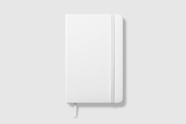 top view of blank photorealistic notebook mockup on light grey background. - diario foto e immagini stock