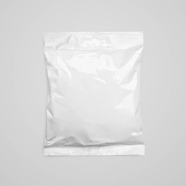 top view of blank plastic pouch food packaging on gray - crisp packet stock photos and pictures