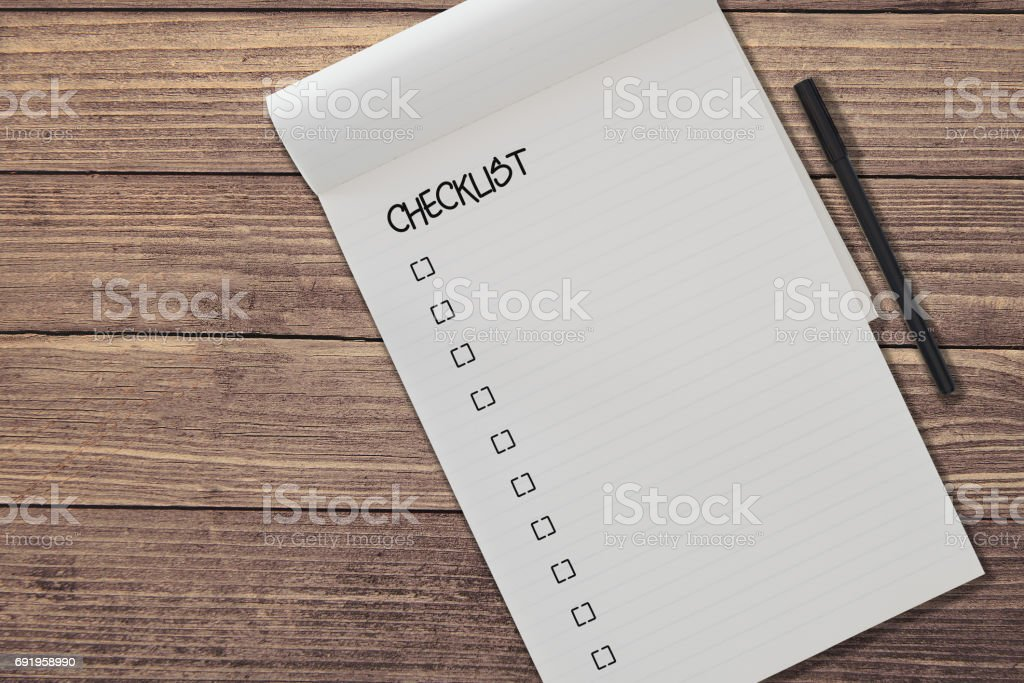 top view of blank ruled notepad with chicklist and pen side by side on rustic wooden table background template stock photo