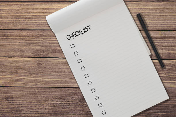 top view of blank ruled notepad with chicklist and pen side by side on rustic wooden table background template - checklist stock photos and pictures