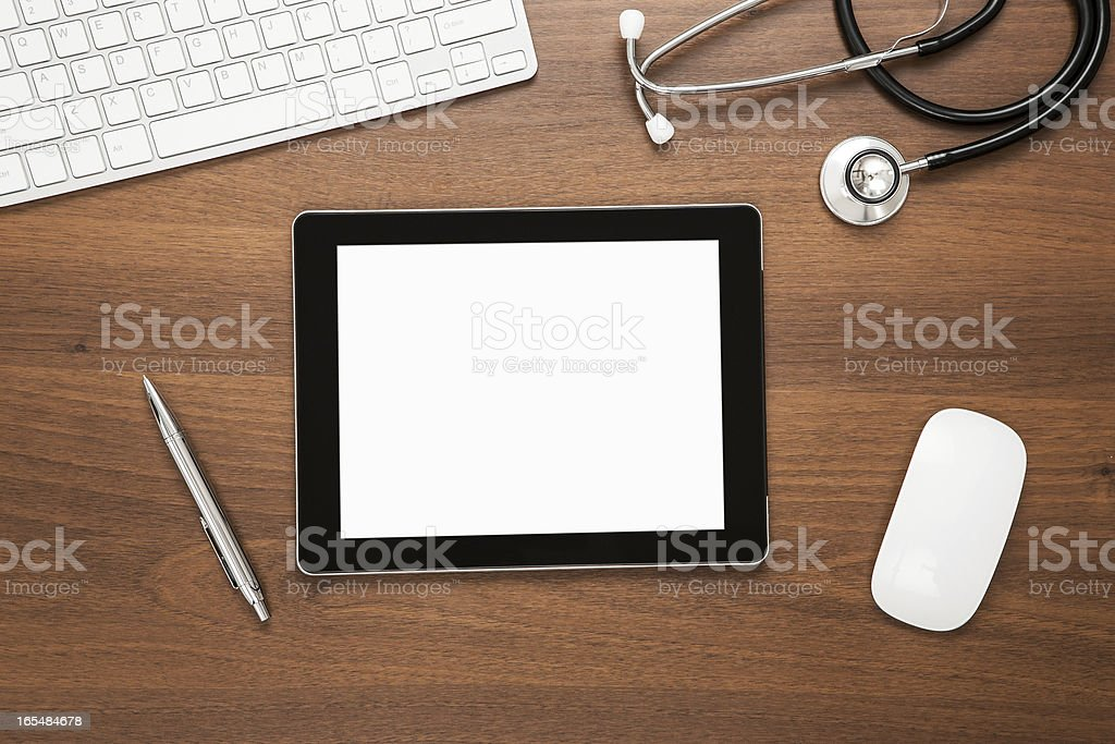 Top view of blank screened tablet on wooden desk royalty-free stock photo