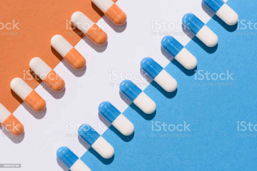 top view of blue and orange pills on colorful surface royalty-free stock photo