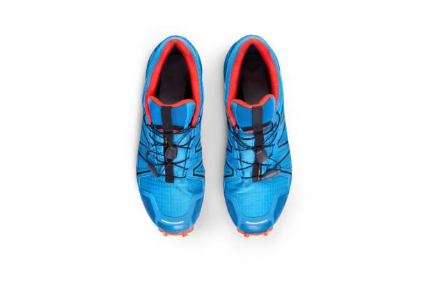 top view of blue and orange trainers - but sportowy zdjęcia i obrazy z banku zdjęć