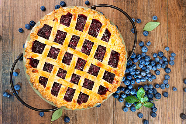 top view of blueberry pie with lattice crust - blueberry pie stock pictures, royalty-free photos & images