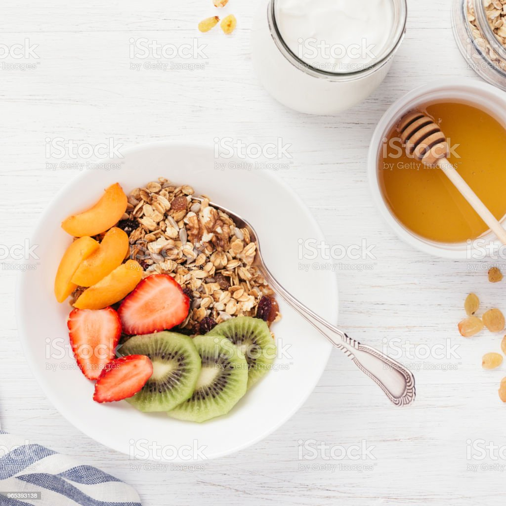 Top view of bowl with granola and fresh fruits. royalty-free stock photo