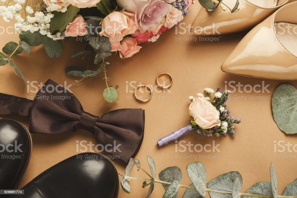 Top view of bride and groom shoes, two gold rings stock photo