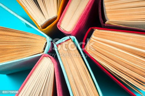 istock Top view of bright colorful hardback books in a circle. 635759596
