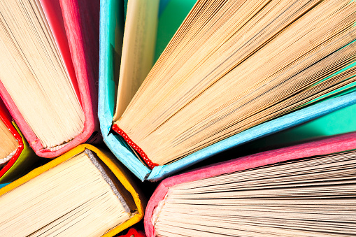 istock Top view of bright colorful hardback books in a circle. 806748998