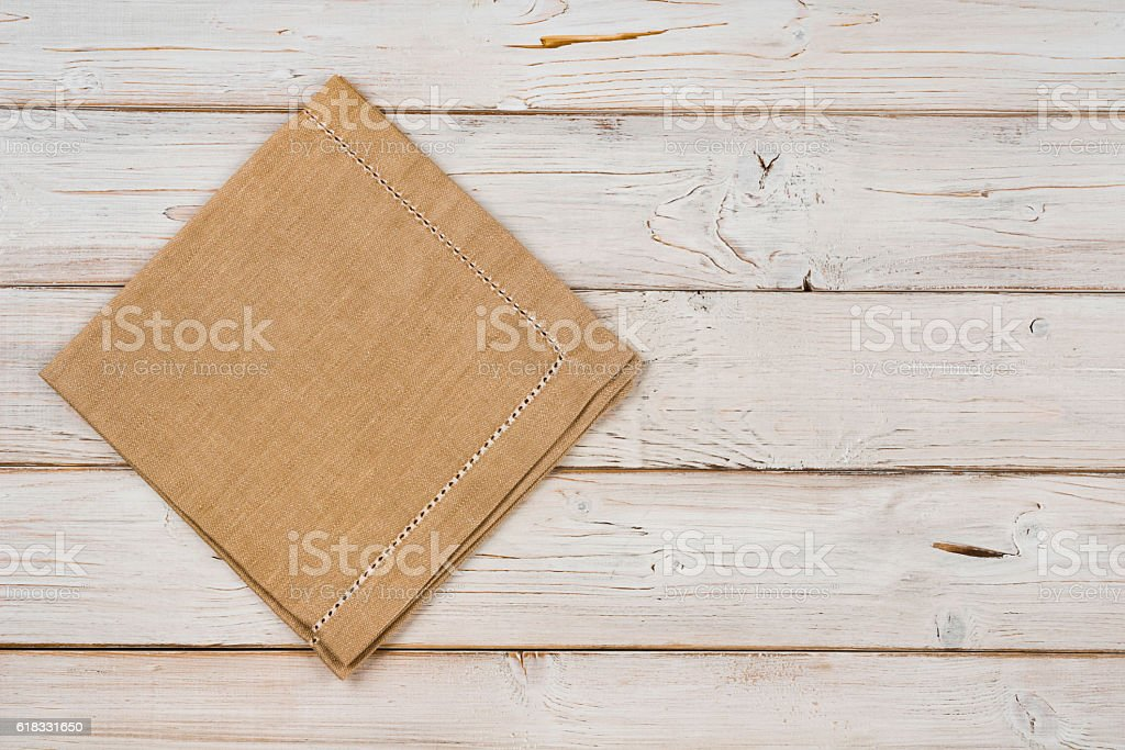 Top view of brown kitchen napkin on wooden planks background stock photo