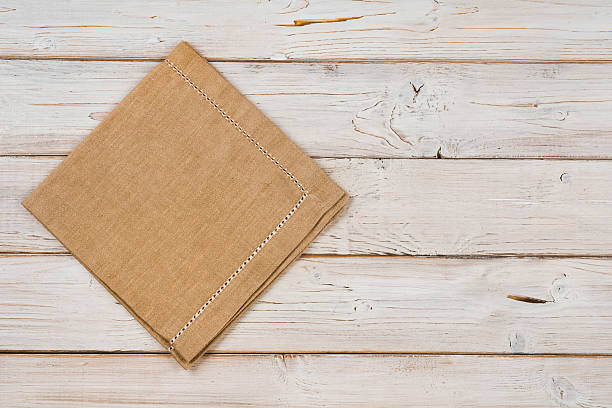 top view of brown kitchen napkin on wooden planks background - ランチョンマット ストックフォトと画像