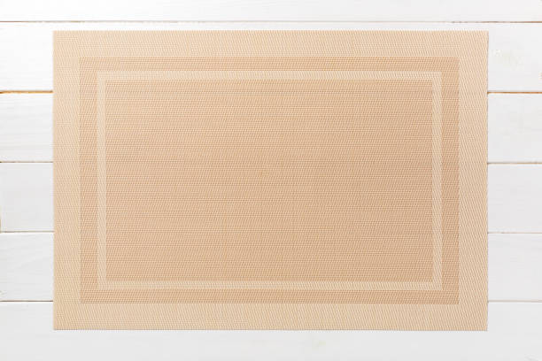 Top view of brown place mat for a dish. Wooden background with empty space for your design stock photo