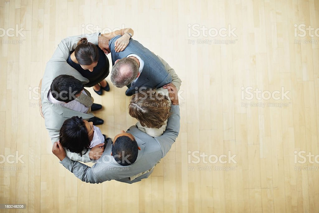 Top view of business colleagues standing in a huddle royalty-free stock photo