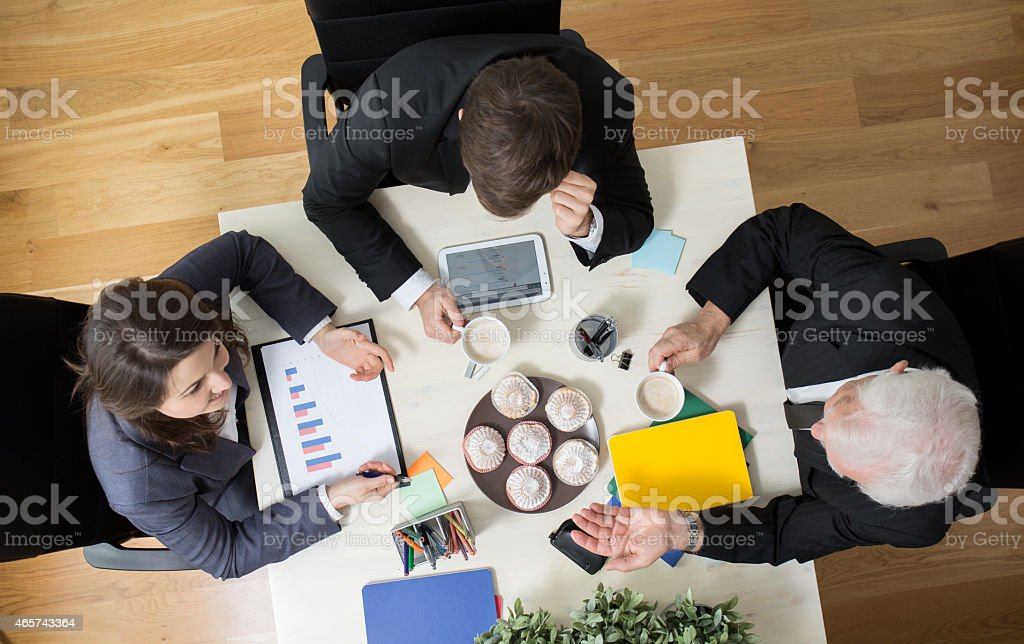 Top view of business conference at small table stock photo