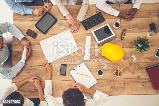 istock Top view of business people on a meeting 639197990