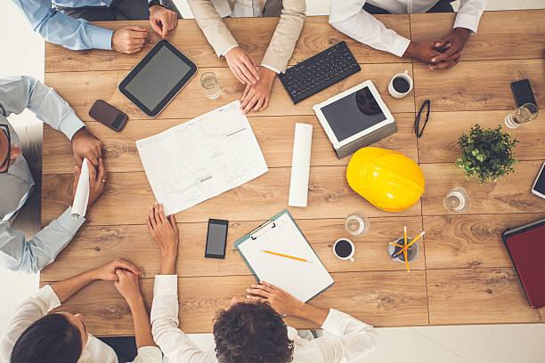 top view of business people on a meeting - hand constructing industry stockfoto's en -beelden