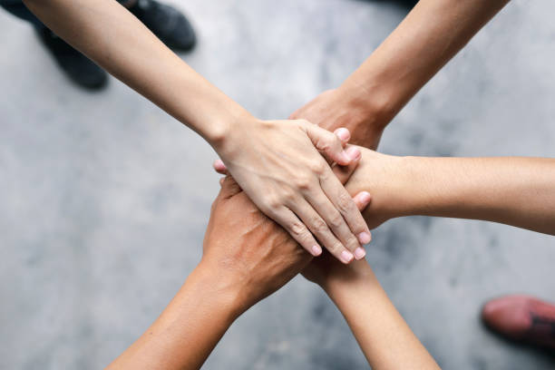 Top view of business people put hands together. Team work and unity business concept stock photo