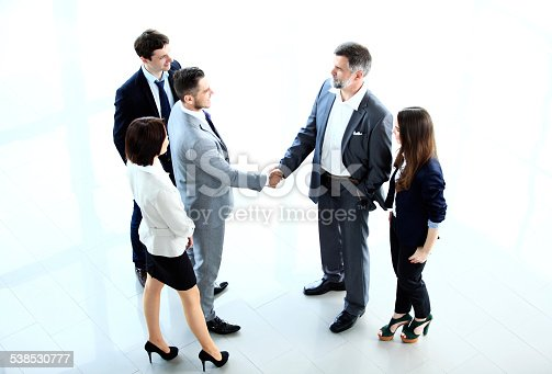656005826istockphoto Top view of  business people shaking hands 538530777
