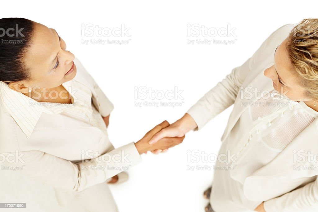 Top view of business women shaking hands royalty-free stock photo