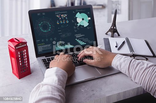 istock Top view of businessman using laptop computer with statistics data on a screen. Working with financial graphs charts, using business software for data analysis and project management concept. 1084925840