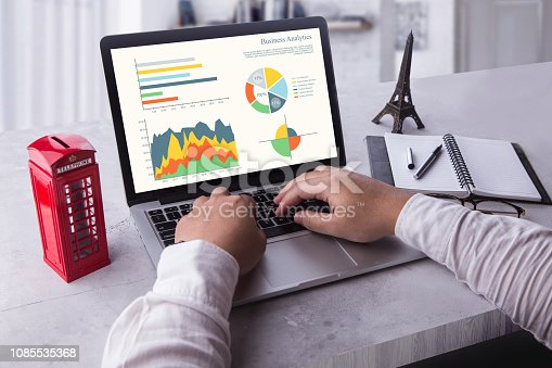 istock Top view of businessman using laptop computer with statistics data on a screen. Working with financial graphs charts, using business software for data analysis and project management concept. 1085535368