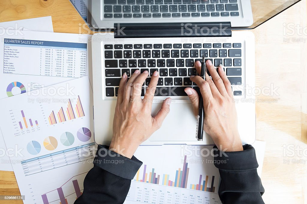 Top view of businesswoman hands working with laptop. stock photo