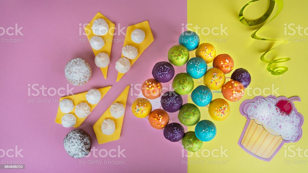Top view of cake pops on a colorful background royalty-free stock photo