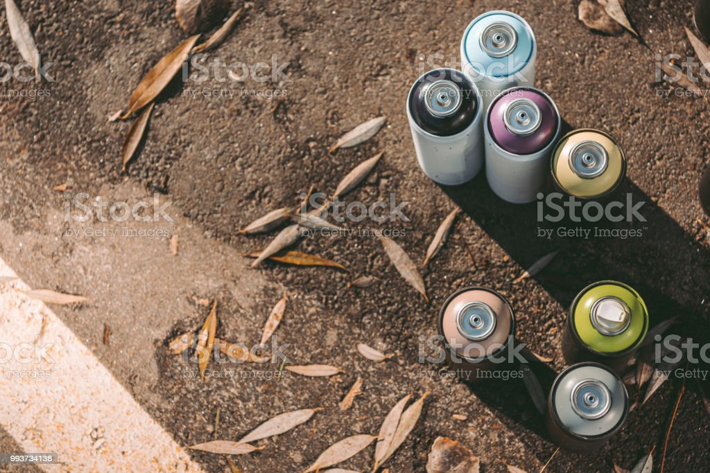 Top View Of Cans With Colorful Spray Paint For Graffiti On