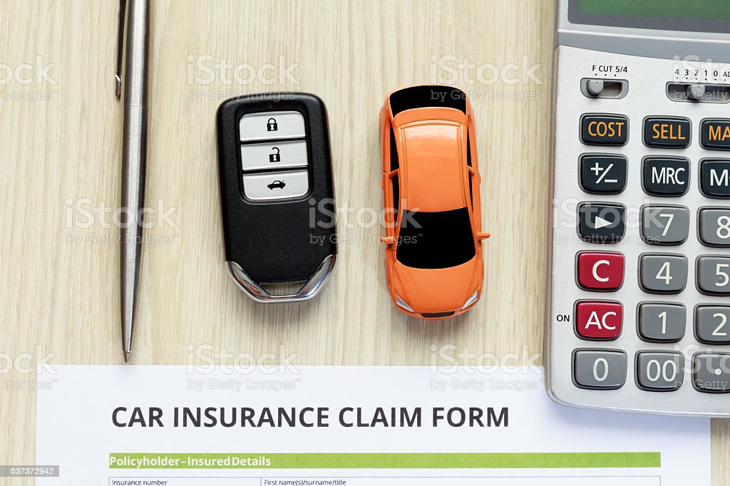 Top View Of Car Insurance Claim Form Witth Car Key Stock Photo