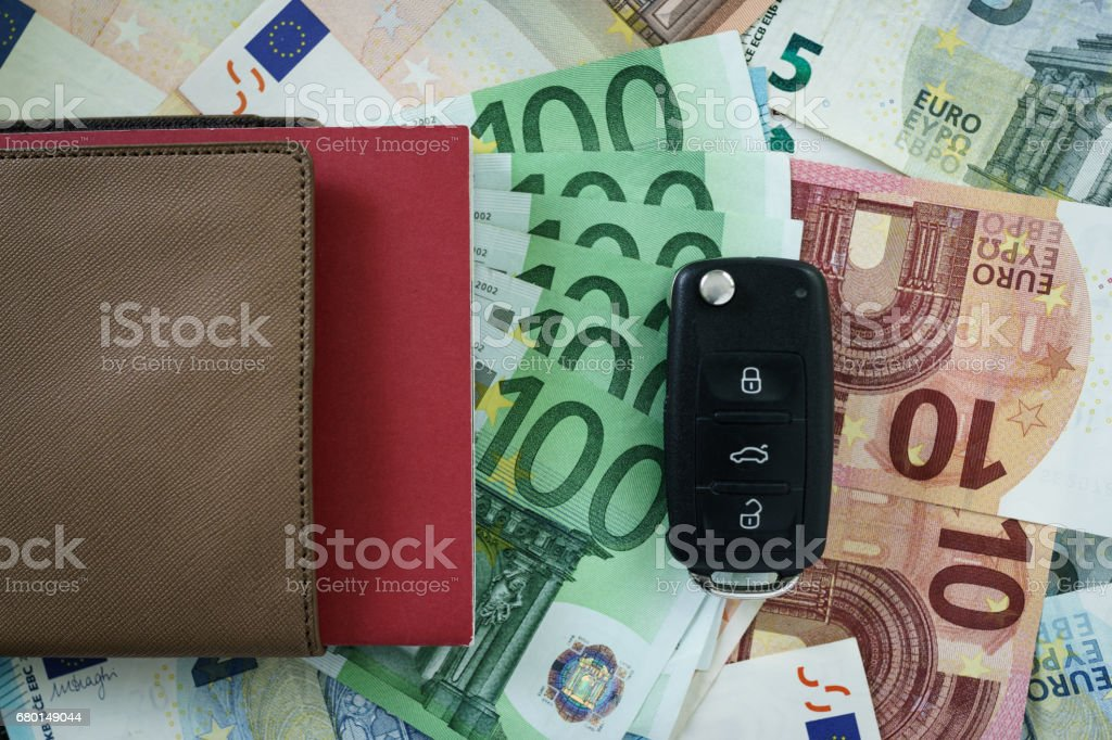 Top View Of Car Key On One Pile Of Euro Banknotes As Car Financial