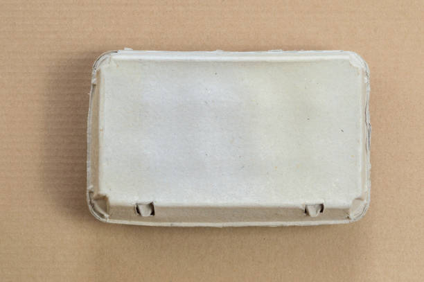 Top view of cardboard egg container on a brown background stock photo