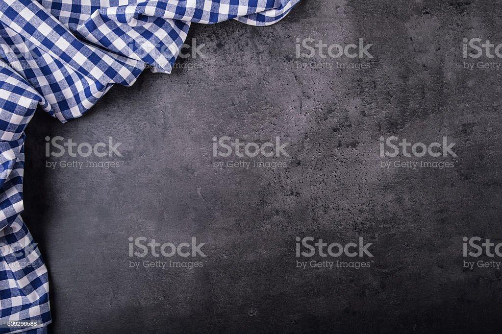 Vue supérieure de cuisine nappe à carreaux sur la Tableau - Photo