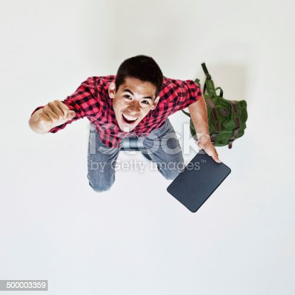 istock Top view of cheerful student with digital tablet 500003359