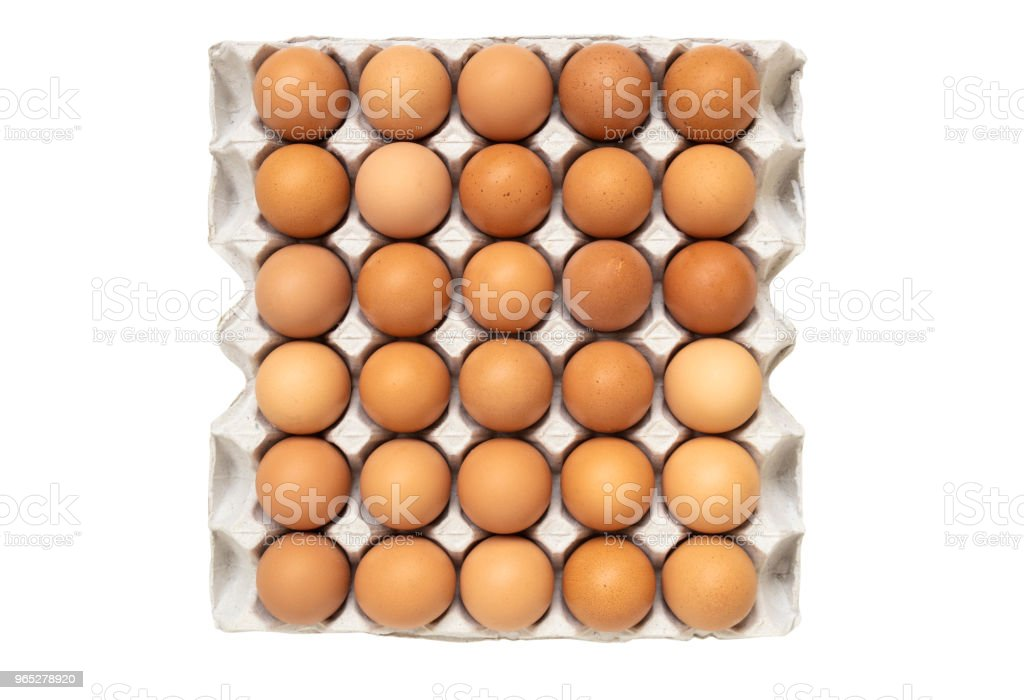 top view of chicken eggs in paper tray isolated on white background royalty-free stock photo