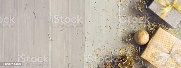 Top view of christmas gift boxes tied with ribbons and gold items picture id1183254408?b=1&k=6&m=1183254408&s=612x612&h=j8v5i hrwlm7e4ka6kz6ujld5cfwdseci tudglmb0o=