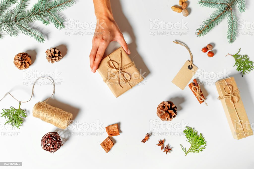 Top view of christmas gift wrapped in craft and decorated stock photo