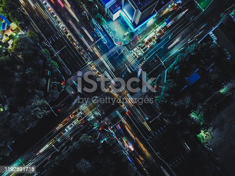 istock Top View of City Street Crossing at Night 1192891718